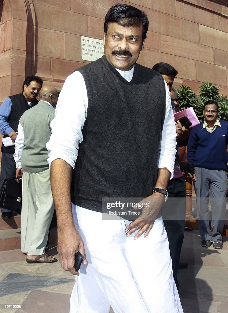 Indian film actor and Minister of State with independent charge for Ministry of Tourism Chiranjeevi leaves Parliament House after attending Parliament Winter Session on November 29, 2012 in New Delhi, India. The logjam in Parliament finally ended after government agreed to the voting on FDI issue. The voting after debate will be held next week on December 4 and 5.