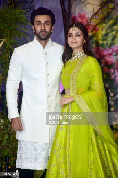 Indian film actor Ranbir Kapoor with actress Alia Bhatt attend the wedding reception of actress Sonam Kapoor and Anand Ahuja at hotel Leela in Mumbai
