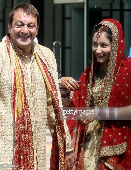 Indian film actor Sanjay Dutt poses with wife and long ...