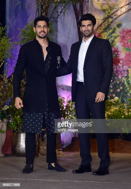 Indian film actor Siddharth Malhotra and Aditya Roy Kapoor attend the wedding reception of actress Sonam Kapoor and Anand Ahuja at hotel Leela in...