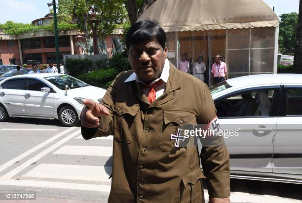 Indian film actor turned politician Naramalli Sivaprasad, arrives at parliament dressed as Adolf Hitler to press for government funding for his home...