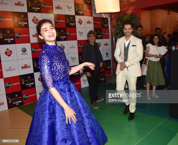 Indian film actor Varun Dhavan and Alia Bhatt attend the Red carpet event of Zee Cine Awards 2018 at MMRDA Ground Bandra in Mumbai