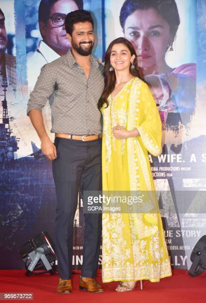 Indian film actor Vicky Kaushal with actress Alia Bhatt pose for a picture during the success party of film Raazi at hotel Taj Lands End Bandra in...