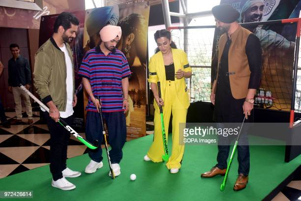 Indian film actors Angad Bedi Diljit Dosanjh Tapsee Pannu with Hockey player Sandeep Singh pose during trailer launch of their upcoming film Soorma...
