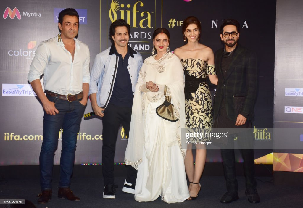 Indian film actors Bobby Deol Varun Dhavan Rekha Kriti Sanon and Ayushmann Khurrana pose during a press conference in Mumbai for the 19th edition of..