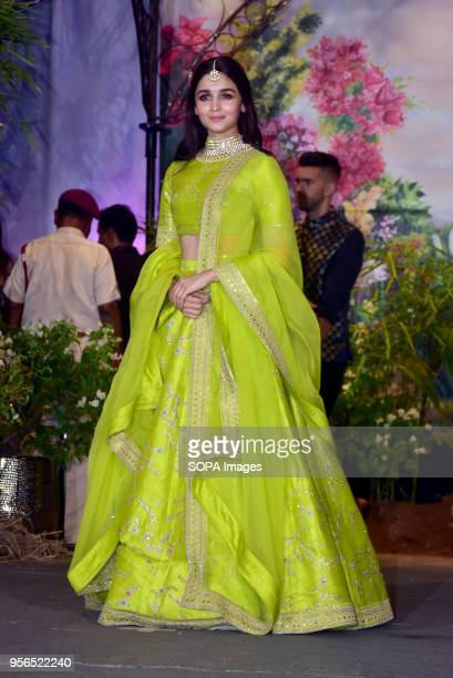 Indian film actress Alia Bhatt attend the wedding reception of actress Sonam Kapoor and Anand Ahuja at hotel Leela in Mumbai
