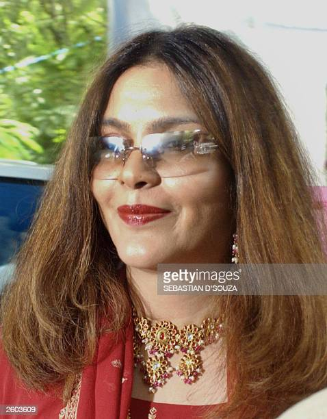 Indian film actress and former Miss World Zeenat Aman smiles as she arrives at the wedding of actress Karishma Kapoor in Bombay 29 September 2003 The...