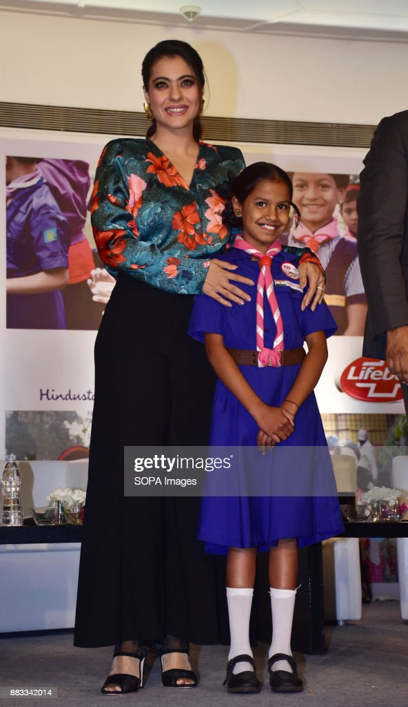 Indian film actress and Lifebuoy Handwashing Ambassador `Kajol` seen posing for a picture with a girl as she join hands with Lifebuoy`s help a child..