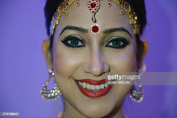 Indian film actress Barsa Rani Bishaya poses as she prepares to perform in a promotional event for tourism in the northeastern state of Assam in...