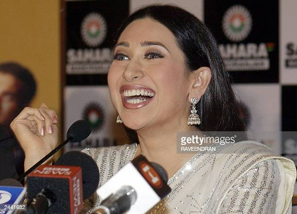 Indian film actress Karishma Kapoor smiles as she addresses a press conference in New Delhi 22 August 2003 Kapoor announced her televison debut in...