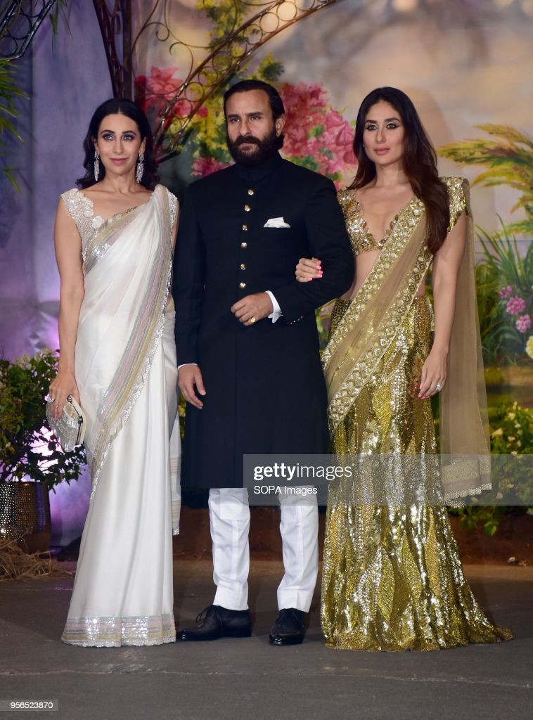 Indian film actress Karisma Kapoor with Saif Ali Khan and Kareena Kapoor Khan attend the wedding reception of actress Sonam Kapoor and Anand Ahuja at.