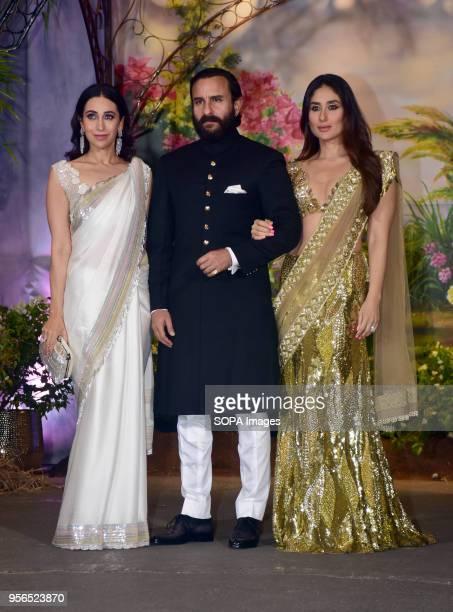 Indian film actress Karisma Kapoor with Saif Ali Khan and Kareena Kapoor Khan attend the wedding reception of actress Sonam Kapoor and Anand Ahuja at...