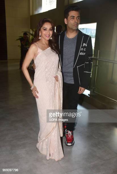 Indian film actress Madhuri Dixit and Director Karan Johar present at the trailer launch of Marathi film 'Bucket List' at Cinepolis Andheri in Mumbai