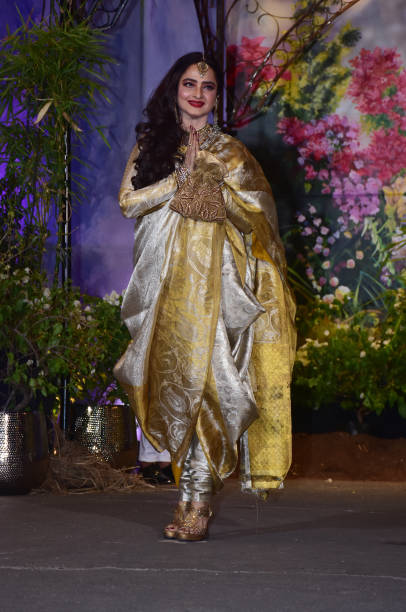 Indian film actress Rekha attend the wedding reception of actress Sonam Kapoor and Anand Ahuja at hotel Leela in Mumbai