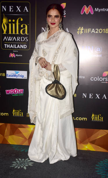Indian film actress Rekha poses during a press conference in Mumbai for the 19th edition of Nexa IIFA Awards which happening in Thailand