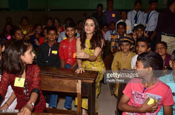 Indian film actress Shraddha Kapoor visited government school on the occasion of Children's Day to spend time with the children of Prabhadevi...