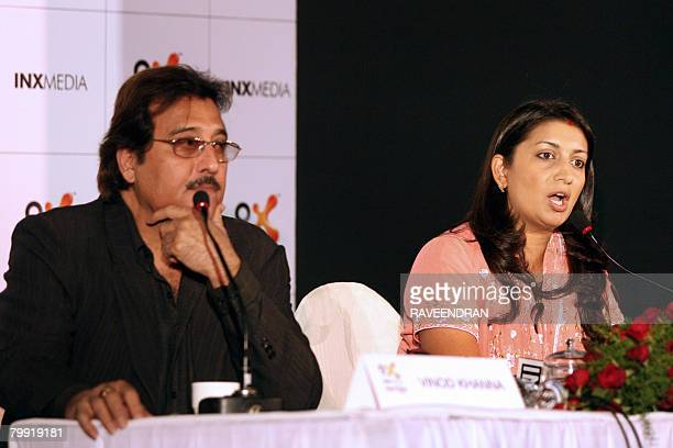 Indian film actress Smriti Irani talks to media representatives as costar Vinod Khanna looks on during a presentation of their new TV serial 'Mere...