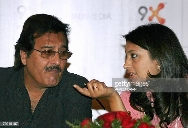 Indian film actress Smriti Irani talks with costar Vinod Khanna during a presentation of their new TV serial 'Mere Apne' in New Delhi on February 22...