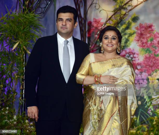 Indian film actress Vidya Balan with husband Siddharth Roy Kapoor attend the wedding reception of actress Sonam Kapoor and Anand Ahuja at hotel Leela...