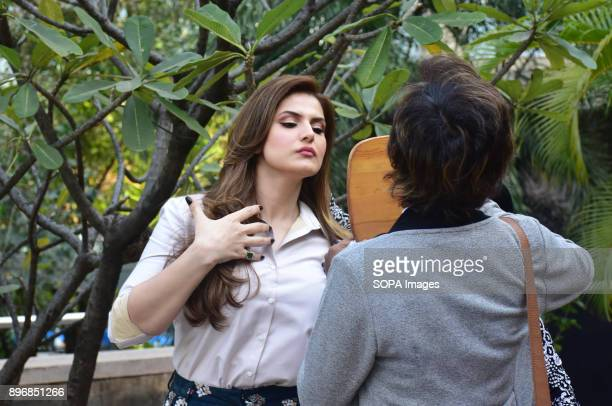 Indian film actress Zareen Khan seen looking at herself in the mirror during a promotional event of her film '1921' at hotel Novotel juhu in Mumbai