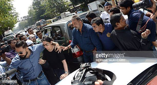 Indian film producer Bunty Walia escorts Bollywood actor Sanjay Dutt along with his wife Manyata Dutt as they arrive to pay their respects at the...