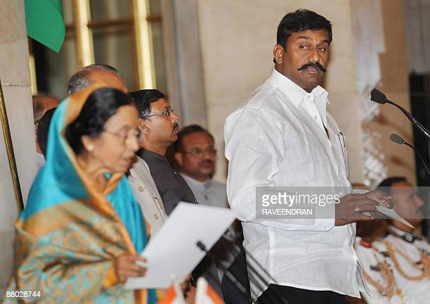 Indian film star and leader of Dravida Munnettra Kazhagham from Tamil Nadu Napoleon takes the oath as a Minister of State from President Pratibha...