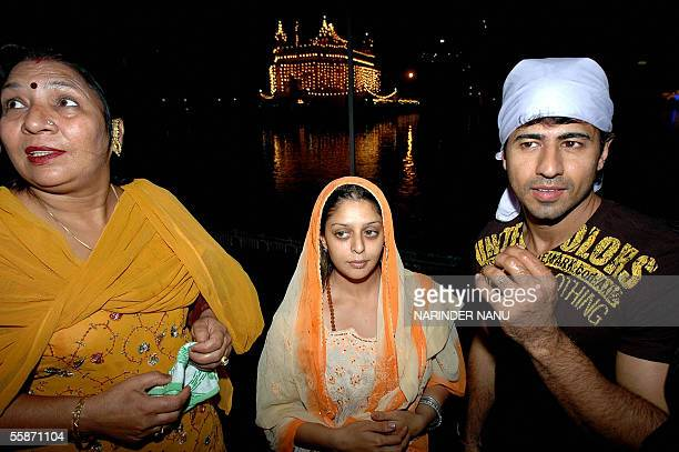 Indian film star Nagma and Aryan Vaid along with producer Deepak are pictured outside the Golden Temple in Amritsar 07 October 2005 Nagma along with...