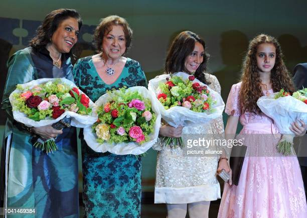 Indian filmmaker Mira Nair host and initiator Elisabeth WickiEndriss Saudi Arabian filmmaker Haifaa Al Mansour and her young actress Waad Mohammed...