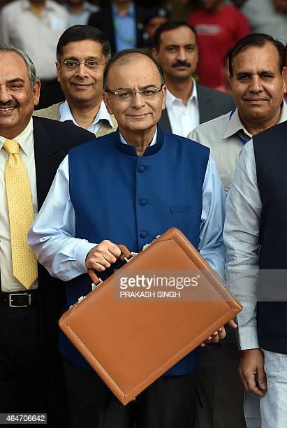 Indian Finance Minister Arun Jaitley leaves the Finance Ministry for Parliament House to table the General Budget 2015 2016 in New Delhi on February...