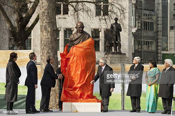 Indian finance minister Arun Jaitley unveils a statue of Mahatma Gandhi in Parliament square in central London on March 14 2015 Gandhi joins figures...
