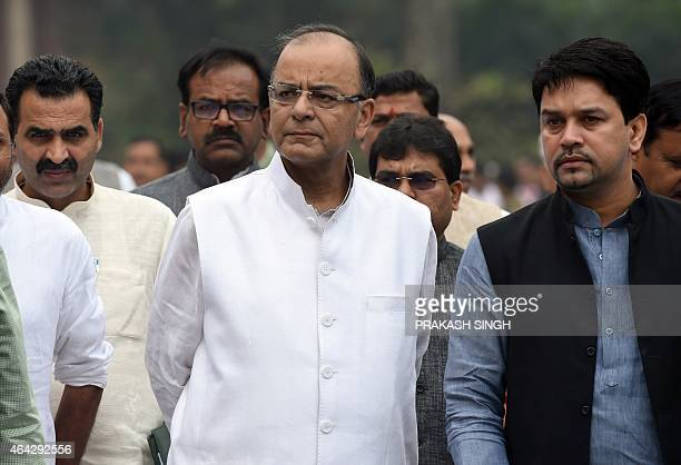 Indian Finance Minister Arun Jaitley walks with party officials and Members of Parliament after a Bharatiya Janata Party Parliamentary Board meeting...