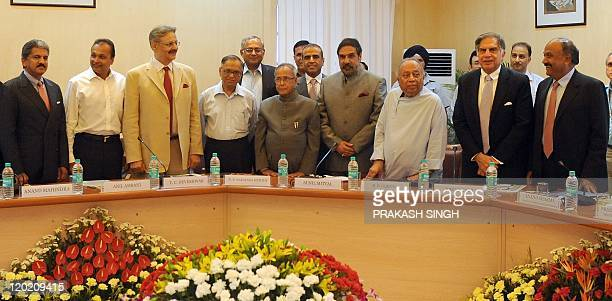Indian Finance Minister Pranab Mukherjee and Minister of State for Finance Anand Sharma pose with business leaders Anand Mahindra , Anil Ambani ,...