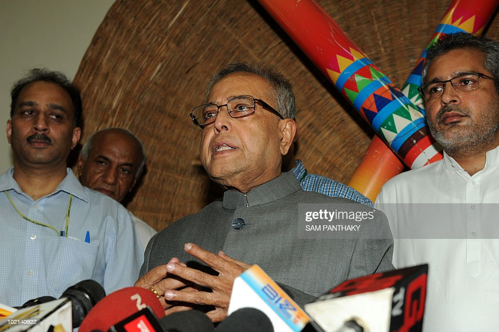 Indian Finance Minister Pranab Mukherjee talks to journalists at the Circuit House in Ahmedabad on June 16, 2010. Mukherjee is on a one-day visit to Gujarat state. AFP PHOTO/Sam PANTHAKY
