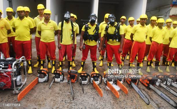 Indian fire fighters stand next to their equipment as they get ready ahead of cyclone Fani landfall in the Indian coastline in Puri in the eastern...
