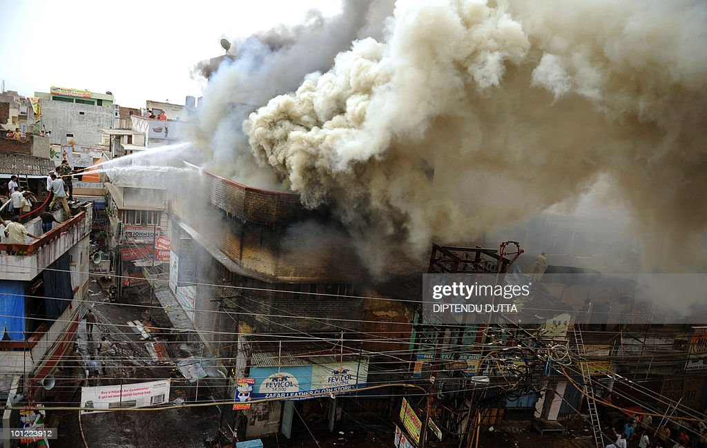 Indian firefighters battle a fire which broke out in a leather goods store room in a market area in Allahabad on May 28, 2010. Thirty fire engines and ten water tankers battled the fire, no casualties were reported.AFP PHOTO/Diptendu DUTTA