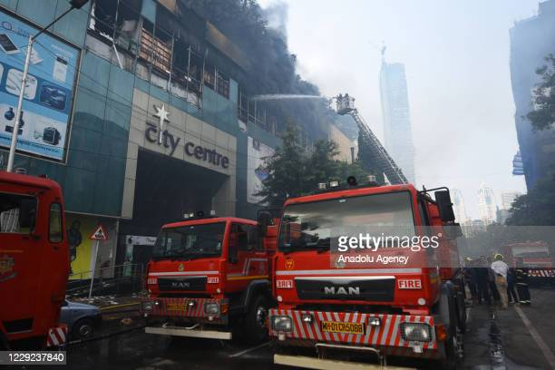 Indian firefighters douse a fire at the City Centre shopping mall in Mumbai on October 23, 2020.