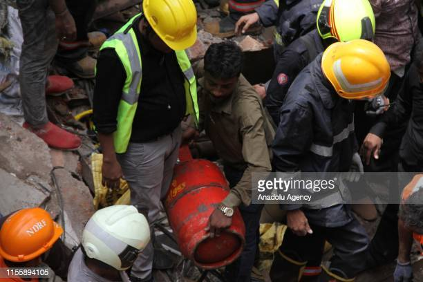 Indian firemen carry out search and rescue works at the site of a building that collapsed in Mumbai India on July 16 2019 A fourstory residential...