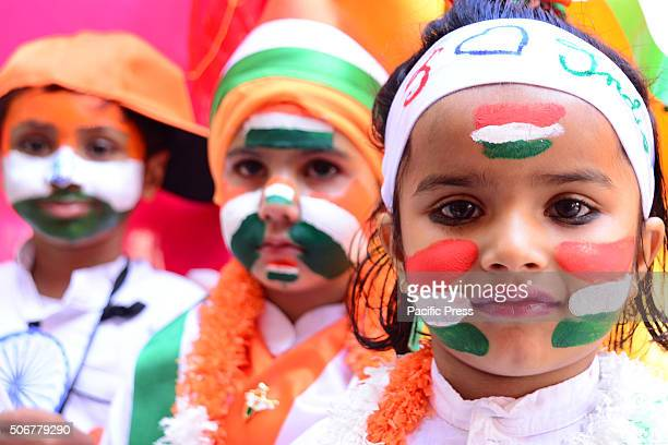 Indian first step school children paint the tricolor of Indian flag on their face and raise the National Flag on the eve of republic day celebrations...
