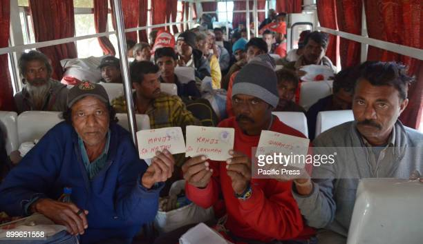 Indian fishermen arrive at a railway station after being released from a jail in Karachi queue to board into buses on the way for their homeland...