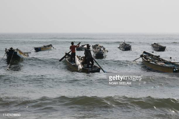 TOPSHOT Indian fishermen head out on a boat to fish in the Indian ocean at Peda Jalaripeta in Visakhapatnam on May 9 2019 After Cyclone Fani...