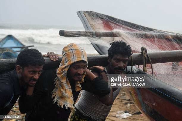 Indian fishermen pull a boat to higher ground on a beach in Puri in the eastern Indian state of Odisha on May 2 as Cyclone Fani approached the Indian...