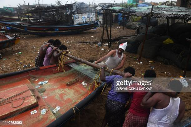 TOPSHOT Indian fishermen pull a boat to higher ground on a beach in Puri in the eastern Indian state of Odisha on May 2 as Cyclone Fani approached...