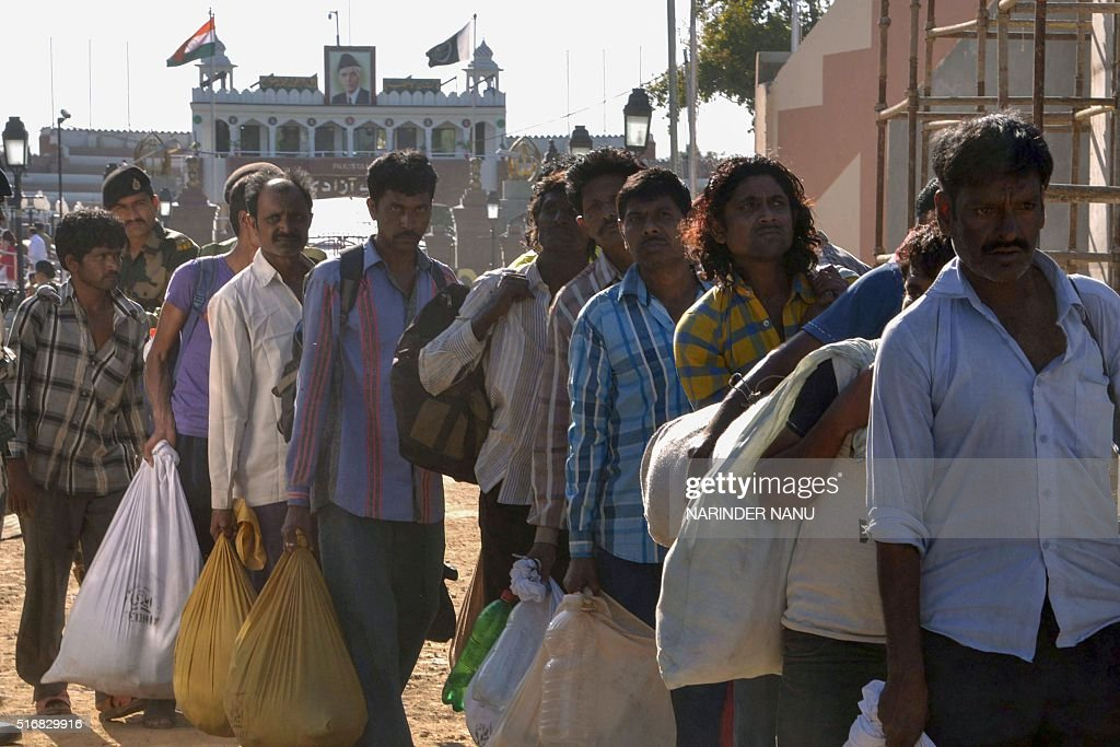 Indian fishermen released by Pakistan cross over at the IndiaPakistan border in Wagah about 35 km from Amritsar on March 21 2016 Pakistan on March 21.