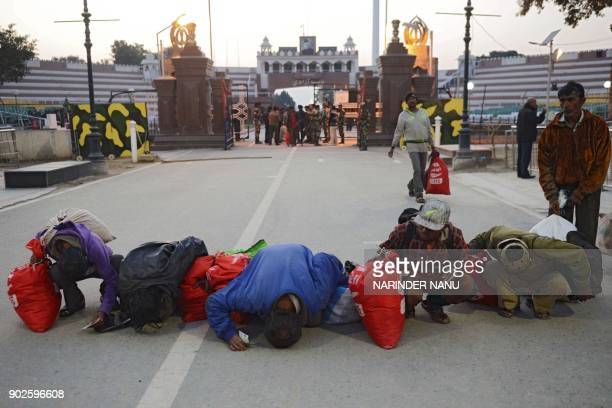 Indian fishermen released by Pakistani authorities kiss the ground after crossing the IndiaPakistan Wagah border some 35kms west of Amritsar on...
