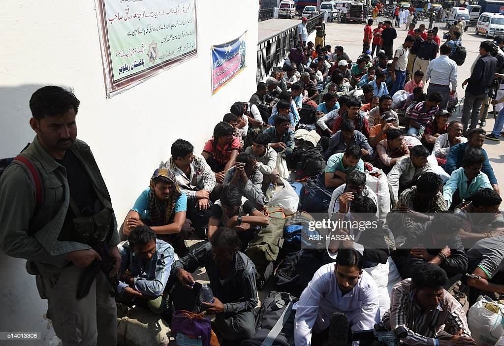 Indian fishermen released from Landhi prison wait for a train to Lahore on their way back to India at a railway station in Karachi on March 6 2016...