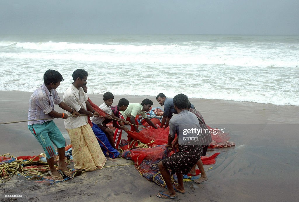 Indian fishermen struggle to pack their nets on a beach in Vishakhapatnam on May 20, 2010, in the path of Cyclone Laila. A severe cyclone packing winds of 110 kilometres an hour closed in on India's southeast coast as tens of thousands of people evacuated their homes fearing major storm damage. Cyclone Laila was expected to hit the state of Andhra Pradesh later in the day, with forecasters warning of a sea surge and disrupted power and communication lines. As heavy rain and strong gales battered the coast, state authorities said at least 30,000 people had been evacuated from low-lying areas.