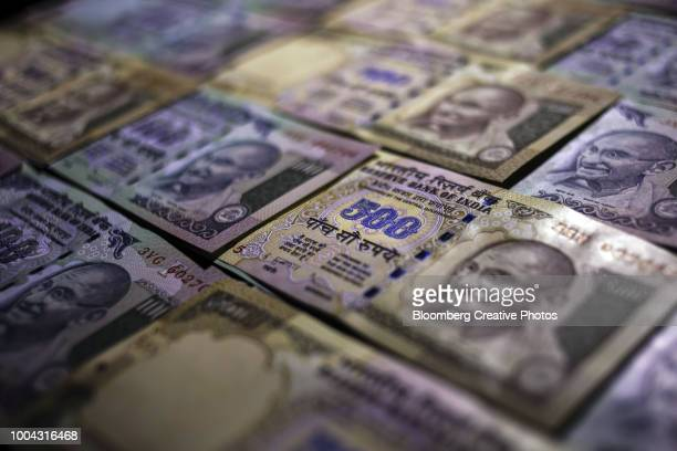 indian five hundred and one hundred rupee banknotes - indian currency stock photos and pictures
