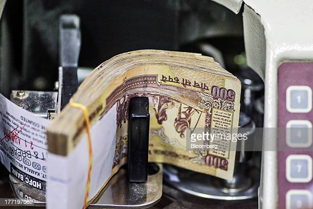 Indian fivehundred rupee banknotes are stacked at a branch of the HDFC Bank Ltd in the Parel area of Mumbai India on Thursday Aug 22 2013 India's...