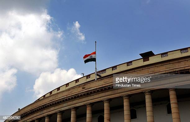 Indian Flag at half mast to mark the demise of former President of Indian APJ Abdul Kalam at the Parliament House on July 28 2015 in New Delhi India...