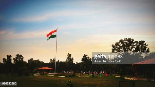 indian flag at park against sky during sunset - indian flag stock pictures, royalty-free photos & images